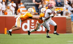 John Metchie (No. 8) of Alabama running through Tennessee defenders