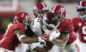 Malachi Moore (No. 13) helps Alabama DB's tackle RB Jo'quavious Marks of Miss. State