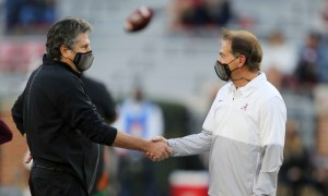 Nick Saban and Mike Leach shake hands in pregame