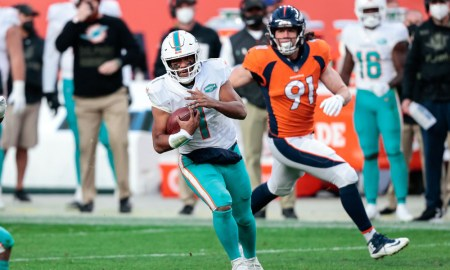 Tua Tagovailoa runs with the ball versus Denver Broncos