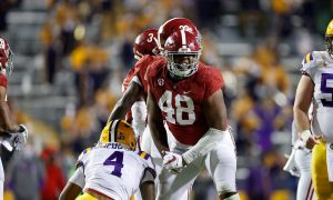 Alabama DL Phidarian Mathis celebrates against LSu