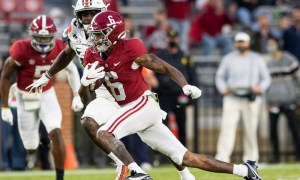 DeVonta Smith (No. 6) running with the ball for Alabama versus Auburn