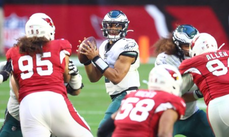 Jalen Hurts in the pocket for Eagles attempting a pass versus Cardinals