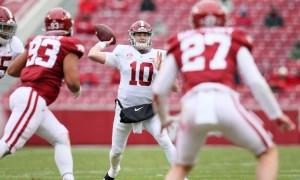 Mac Jones fires a pass downfield against Arkansas