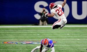 Najee Harris of Alabama hurdles Florida defender in SEC title game
