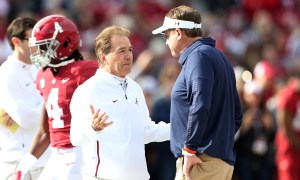 Alabama HC Nick Saban talks with Gus Malzahn before Iron Bowl