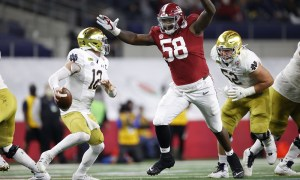 Christian Barmore of Alabama pressure Notre Dame's Ian Book in the Rose Bowl