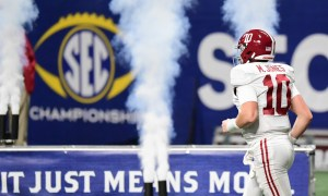 Mac Jones comes out of tunnel for Alabama at SEC Championship Game