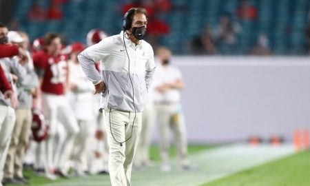 Nick Saban watches a play from the sidelines of the national championship