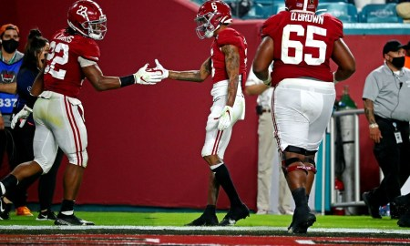 Najee Harris and DeVonta Smith celbrate during National Championship
