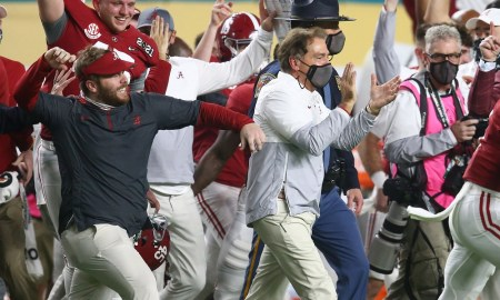 Alabama football and Nick Saban runs on the field after the National Championship win