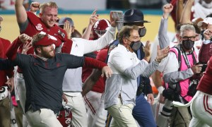 Alabama football head coach Nick Saban rushes the field