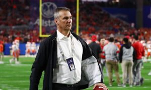 Urban Meyer walks the sidelines ahead on an Ohio State game