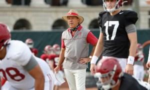 Nick Saban looks on as Alabama goes through spring practice