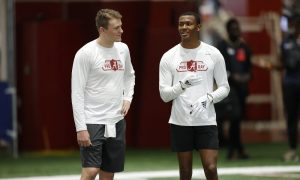 Mac Jones and DeVonta Smith chat during their pro day