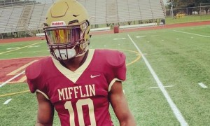Nicholas Singleton poses for picture in Mifflin football uniform