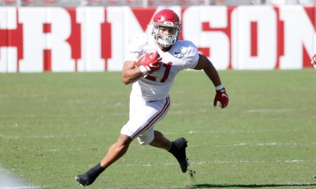 Jase McClellan (No. 21) runs with the ball in Alabama's spring scrimmage