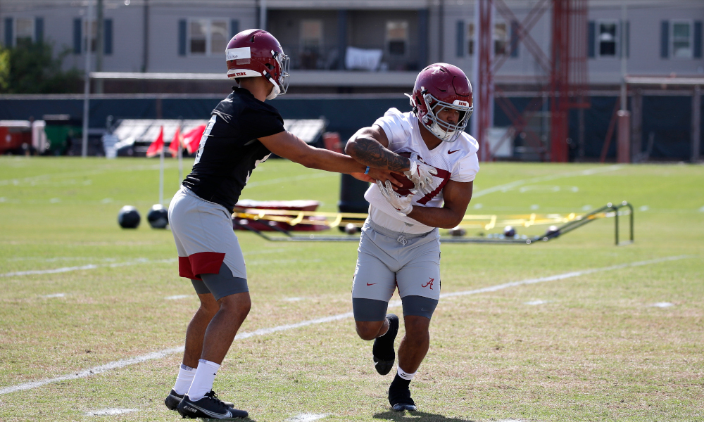 Bryce Young hands the ball to Kyle Edwards (No. 27) at Alabama spring practice