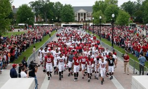 Alabama football playing walking into Bryant-Denny Stadium for A-Day