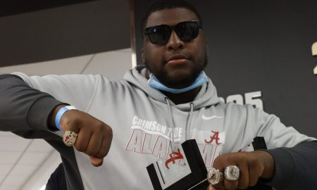 Phidarian Mathis shows off his championship rings