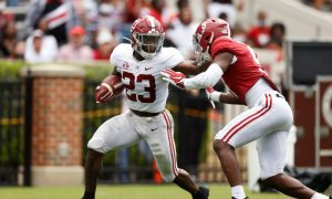 Roydell Williams stiff arms Jordan Battle during A-Day
