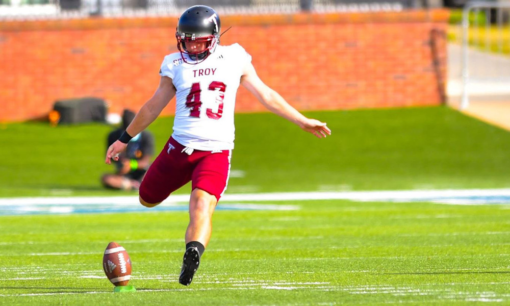 Jack Martin (No. 43) executes a kickoff for the Troy Trojans in 2020. He has committed to the Crimson Tide via Twitter