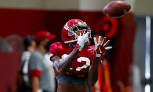Ronald Williams catches an interception during practice