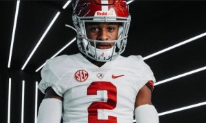 Earl Little wears Alabama uniform during visit