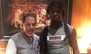 Kavion Henderson poses with Nick Saban during Alabama visit