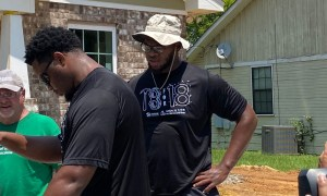 Evan Neal participating in Habitat for Humanity with Nick's Kids Foundation