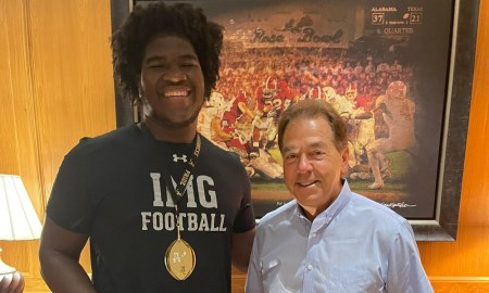 Nick Saban and Tyler Booker smile for picture