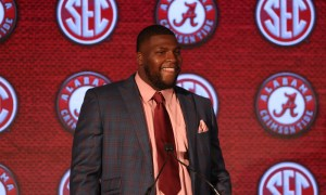 Alabama DL Phidarian Mathis smiling during an interview with reporters at SEC Media Days