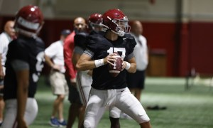 Paul Tyson (No. 17) drops back in pocket during Alabama practice