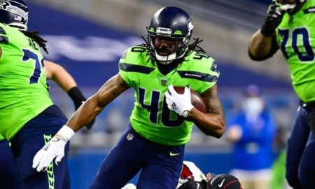 Bo Scarbrough carries the ball for the Seattle Seahawks