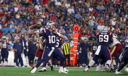Mac Jones throws a pass for Patriots in NFL Preseason Game versus Washington