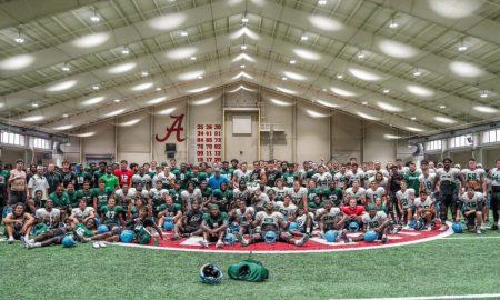Tulane takes a team photo inside Alabama's practice facility
