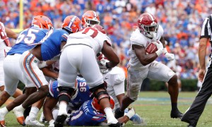 Brian Robinson (#4) breaks a tackle for Alabama against Florida