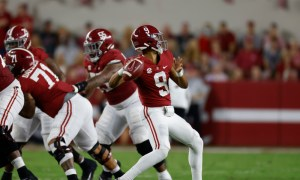 Bryce Young (#9) draws back to throw a pass for Alabama versus Southern Mississippi