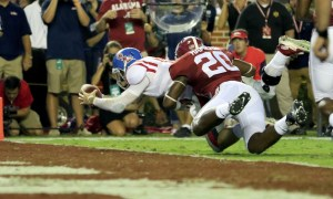 Chad Kelly (#10) dives into the end zone for an Ole Miss touchdown in 2015 versus Alabama