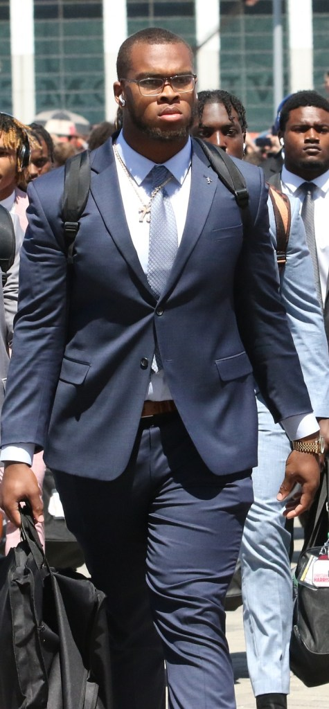 Evan Neal walking into the stadium with his pregame suit