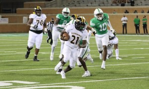 Frank Gore Jr. (#21) runs with the ball for Southern Mississippi in 2020
