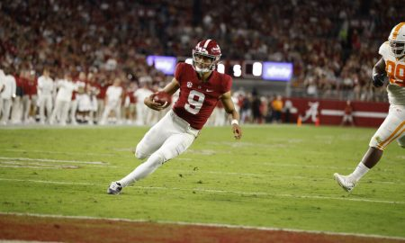 Bryce Young scrambles to the endzone against Tennessee