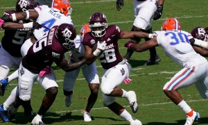 Isaiah Spiller (#28) runs with the ball for Texas A&M versus Florida in 2020