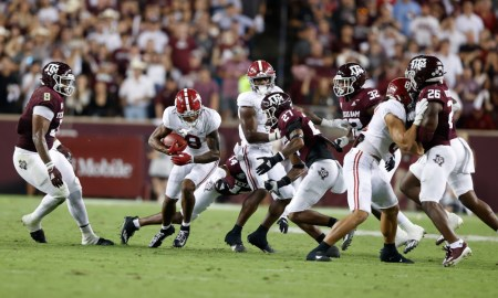 John Metchie (#8) with the ball for Alabama versus Texas A&M