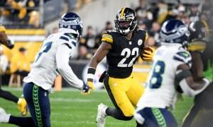 Najee Harris (#22) runs with the football for Steelers versus Seahawks