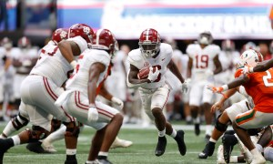 Trey Sanders (#6) runs with the ball for Alabama versus Miami
