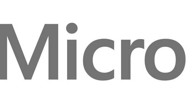 (Microsoft logo) Four colored squares arranged to show one large square. Top squares in red and green. Bottom squares in blue and yellow. Followed by company name in black: MICROSOFT