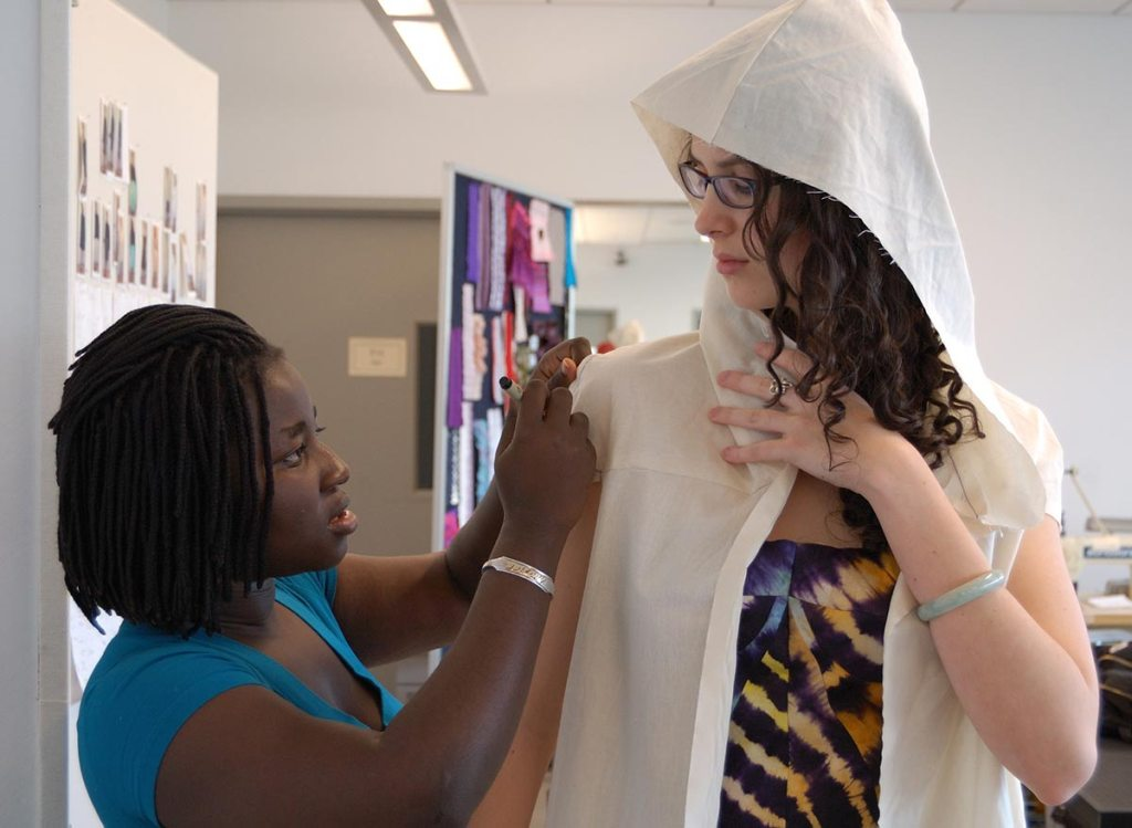 Matilda Ceesay draping the malaria-fighting dress. [Image: Mark Vorreuter]