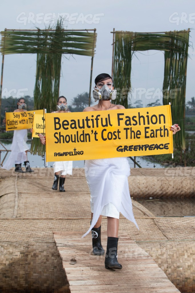 "Indonesian models presenting Eco Fashion from  3 different designer  Felicia Budi, Indita Karina, Lenny Agustin during ""Detox Catwalk"" on damage paddy field area in Rancaekek, West Java province on Sunday 22 March 2015. [Photo Greenpeace/Hati Kecil Visuals]"