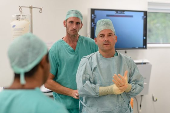 Mr. Tim Dudderidge and his team in theatre at Southampton's Spire private medical clinic.